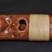 Donan flauta māori al Museo de las Culturas