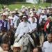 El Bronco... cabalga por toma de protesta, Solalinde lo acompaña